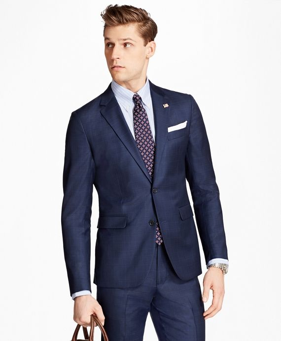 Two-button suit made from 100% wool woven in Italy. Our 1818 Suits feature framed interior pockets to eliminate stress points, hand sewn armholes for added comfort and movement. Fully lined. Crafted in our Milano fit. With side vents, pick stitching and flat-front trousers. Dry clean. Made at our own factory in the USA from imported materials.