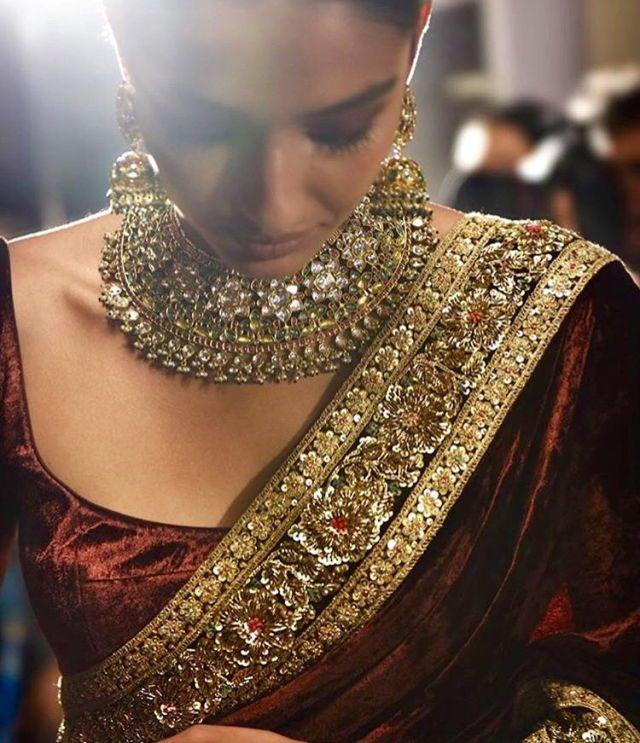 Velvet saree with Zardosi adorned border.