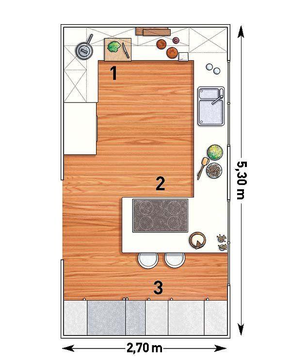 Una cocina rectangular con península