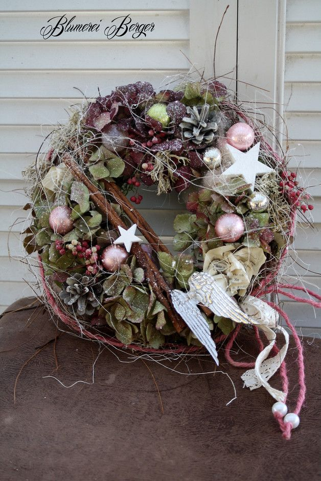 Love the wild look and how branches cross center of wreath