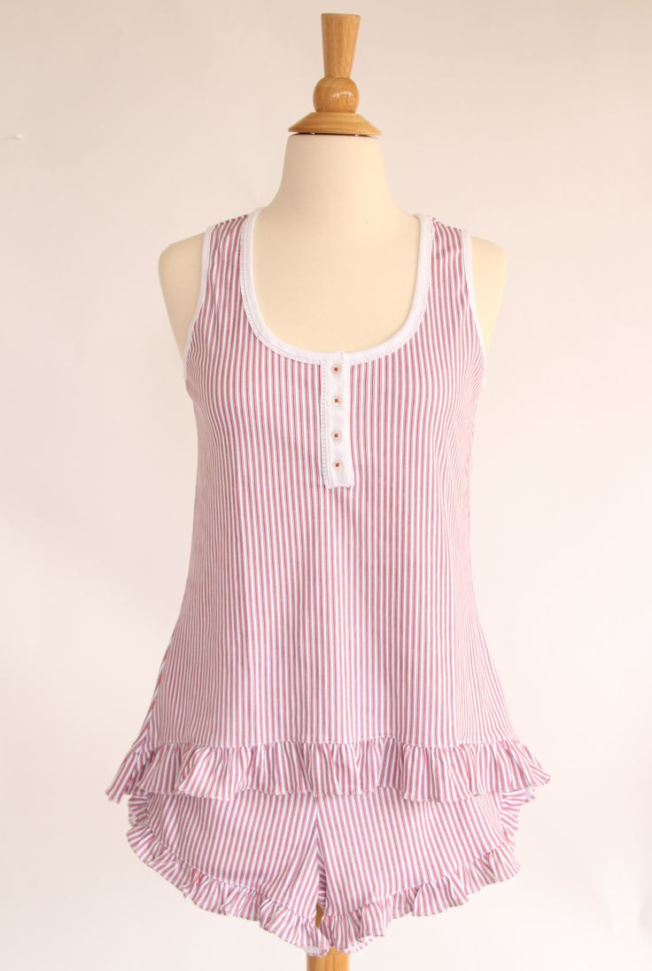 Women's pima cotton sleeveless top with ruffle detail and button placket at neck with matching ruffled shorts.