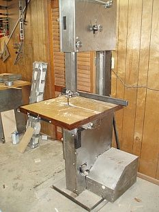 17-Inch Custom Bandsaw - Homemade 17-inch custom bandsaw utilizing 11 gauge tubing and 2x2 angle for the frame, along with off-the-shelf 17-inch wheels. Intended as an aid in cutting lumber for furniture construction.