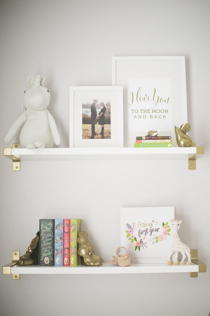 Nursery shelving that's simple and chic goes such a long way in a baby girl nursery