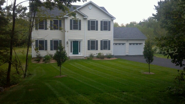 Newly constructed house, new sod lawn, perfect stripes