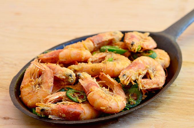 salt and pepper shrimp is a popular Chinese dish made with large shrimp coated in flour, deep-fried and flavored with salt and peppers