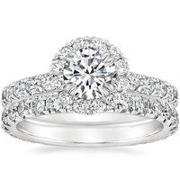 Elegant French pavé-set diamonds form a stunning halo, surrounding the center gem in a ring of brilliant light. Dazzling diamond accents adorn the band and gallery for a truly glamorous effect (average 0.90 total carat weight).