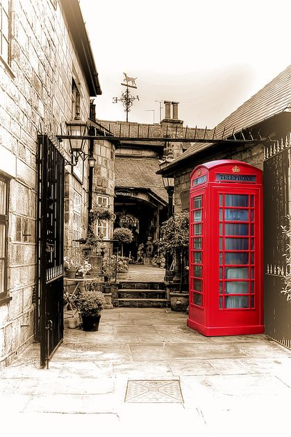 Old Red Phonebox in a small shopping arcade in Harrogate, North Yorkshire, England.