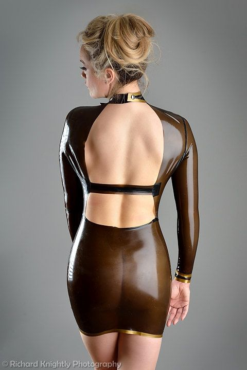 Backless and black trans latex dress modelled by Emma ...
