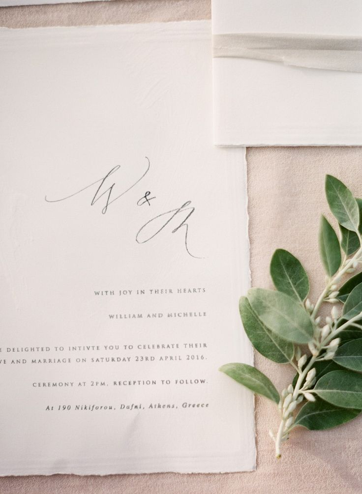 minimal wedding invitation with calligraphy initials