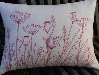 wild flower meadow red work cushion,outline stitched in double stitch (Stretch stitch) on the sewing machine. Details hand embroidered with Guterman sulky cotton machine embroidery thread