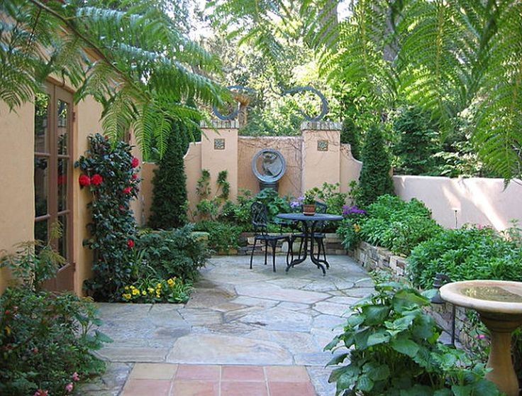 Diy small patio makeovers patio with a lush border for Garden designs for small backyards