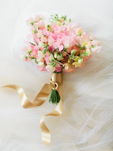 Wrap a pink sweet pea bouquet with a cream ribbon