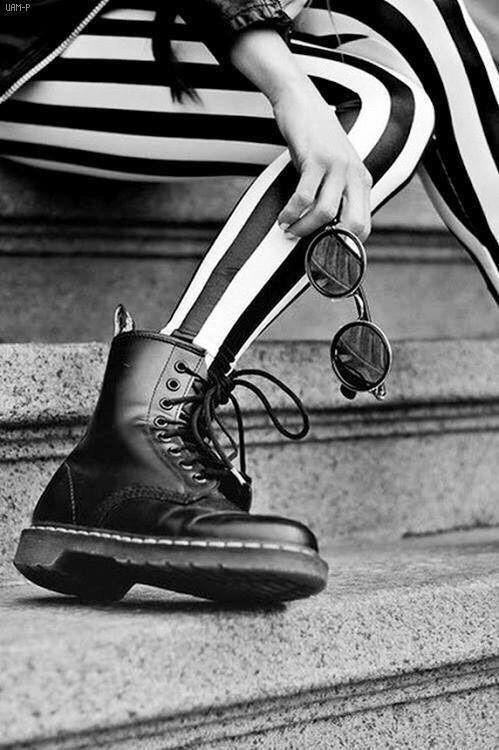 Girl wearing Black & White Striped Stockings & boots