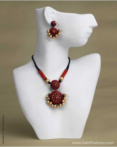 Stunning terracotta necklace and earring set in antique gold and black finish.