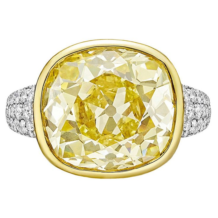 Betteridge 12.10 Carat Fancy Intense Yellow Diamond Ring | From a unique collection of vintage cocktail rings at https://www.1stdibs.com/jewelry/rings/cocktail-rings/