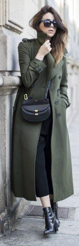 Nicoletta Reggio wears a khaki army-style maxi coat with black culottes and ankle boots. Coat: Asos, T-shirt: Zara, Trousers: Balenciaga, Bag: Chloe, Shoes: Sarenza.