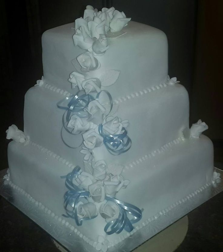 3 tier white wedding cake with cascading flowers by Altefyn Cakes