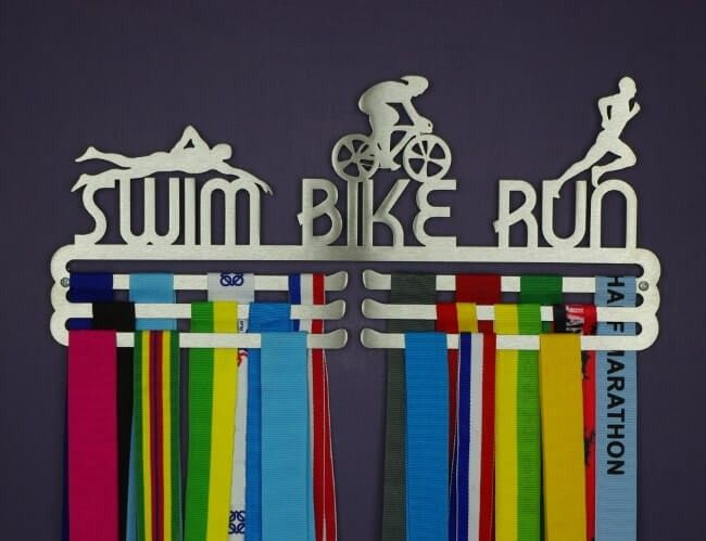 Your triathlon medals represent the hours of dedication you've put in to your three disciplines. So hang them with pride and enjoy your achievements. This beautiful medal display is intricately crafted but sturdy, and will look wonderful on your wall. Our medal hangers are all made in England by people who love running and understand runners. They are high-quality, laser cut in brushed steel, and sturdy. Stunning to look at, these are the perfect way to remember your races.
