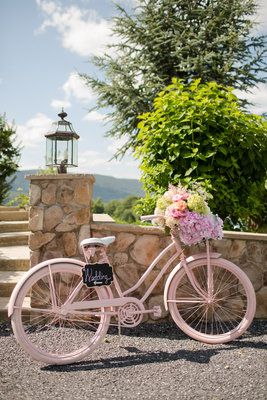 Vintage bike, painted pink bicycle with flowers - wedding decor - photo by Kaitlyn James Photography