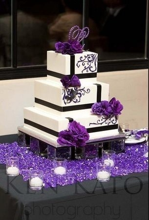 Wedding cake.  The square shapes and offset, black ribbons create a modern feel.    www.BrassTacksEvents.com