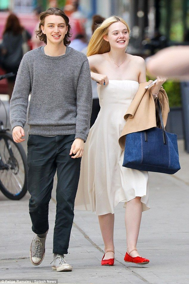 New admirerer? Elle Fanning was spotted out and about in New York City with a mystery man ...