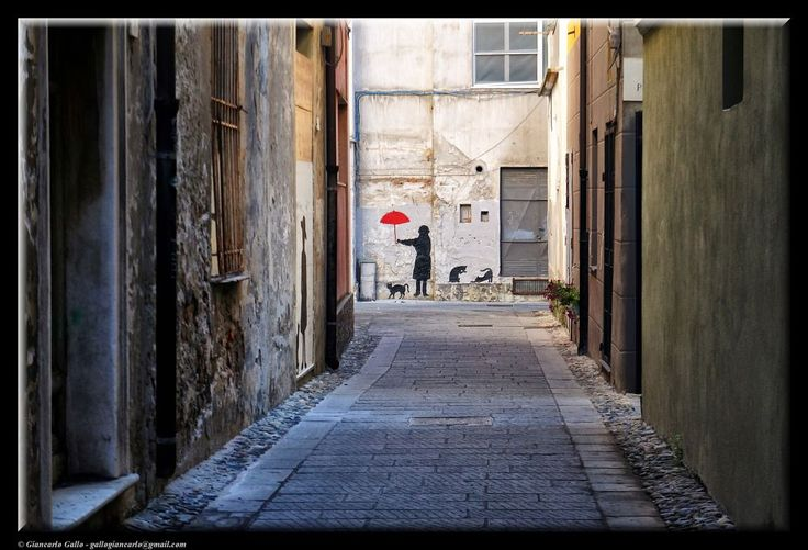 A red umbrella by Giancarlo Gallo