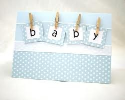 new baby card- a bit plain, needs something more in the bottom blue panel...maybe a small stamped and coloured in baby animal, or some white embossed clouds layered over blue.