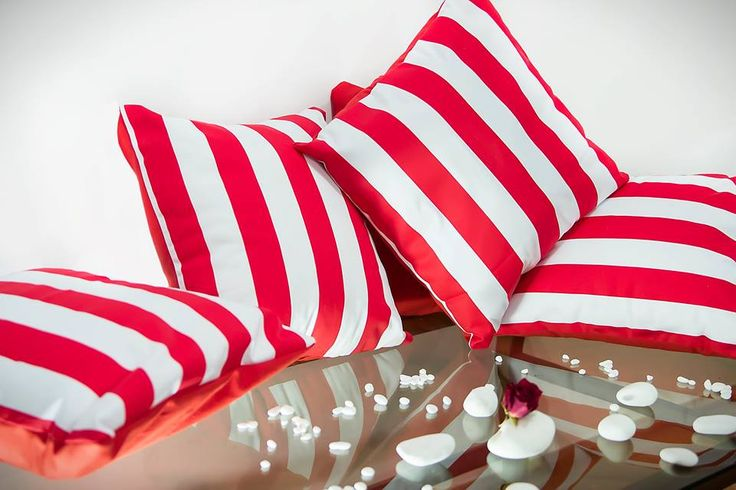 Handmade throw pillows. Red and white on one side and red on the other. Materials: Creton. Pillow inserts included. Made to order