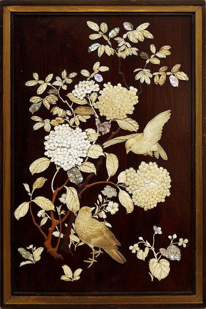 A Japanese ivory inlaid hardwood panel, early 20th century, decorated depicting birds in flight amongst flowers and foliage, 49 cm high.