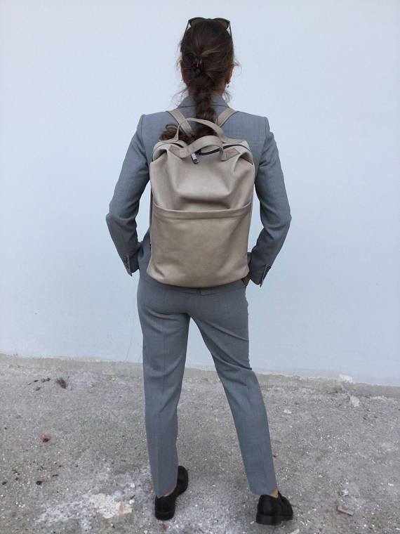 Modern Leather backpack 🎒 By Lara Klass  Bag Made with great care and love of Italian leather . Been designed to be worn in all case.   Leather Zipper Nude Backpack by Lara Klass With front big zipper pocket  Inne...