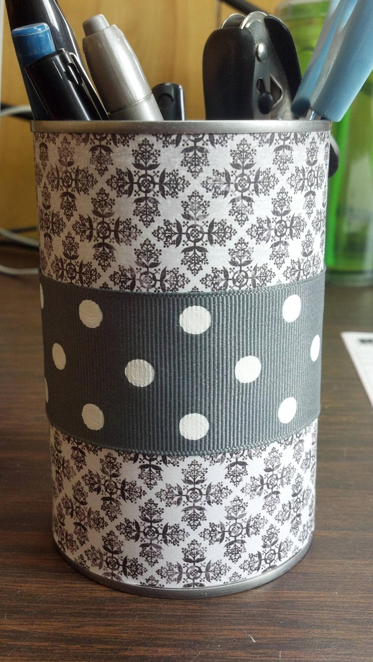 Take a can..modge podge the inside wrap a piece of scrapbook paper around it and then added ribbon for fun. Easy diy pen holder
