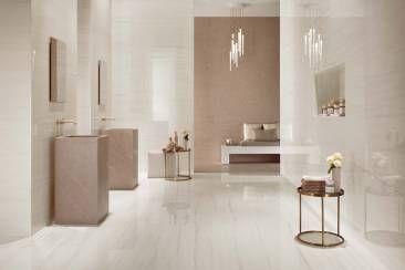 Brillanti pavimenti e rivestimenti effetto marmo per spazi benessere