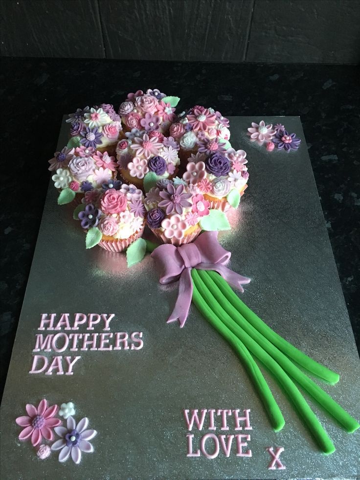 Mothers Day edible flower bouquet. Cupcakes arranged as a bouquet with different shaped and sized fondant flowers on top. Very pretty