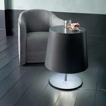 Quirky, smart and functional, the Ray Side Table has a dual personality. From celebrated designer Paola Navone for Italian furniture line Casamilano, the luminous small table features gray painted steel and LED lighting.