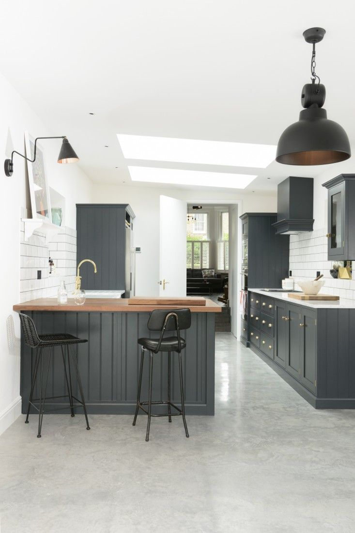 Charcoal cabinets set off by marble and wood counters and subway-tiled walls: The latest design from bespoke kitchen specialists deVol manages to be at once darkly elegant and homey. And yes, that's a British accent you detect.