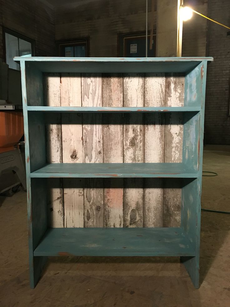 $5 garage sale find, waverly chalk paint, a little sanding, reclaimed fenced board for the back.