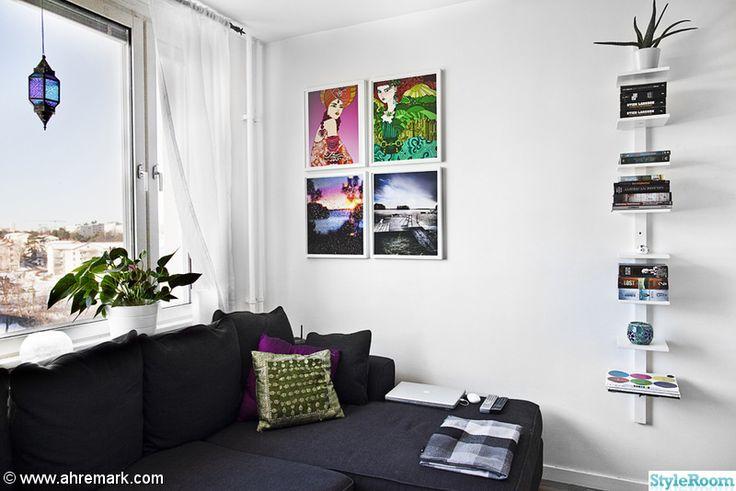 soffa,ramar,tavelvägg,prydnadskuddar,fotovägg