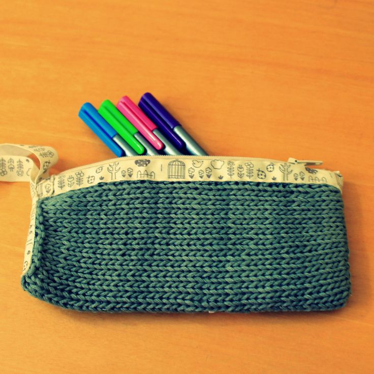 Stationary/Make up bag. Hand knitted with cotton yarn. Lined and with zip.