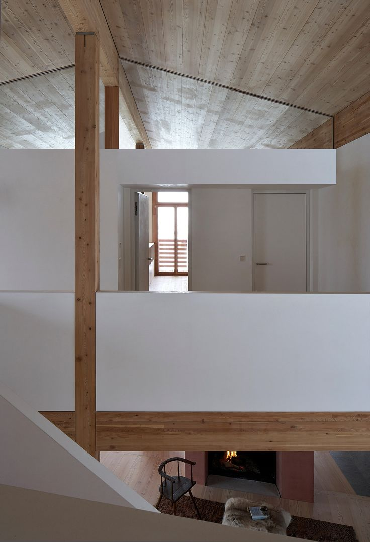 Rothaus | Jonathan Tuckey Design, Andermatt, Switzerland. Engineered larch timber-frame structure, Larch joinery and walls finished with natural plaster.