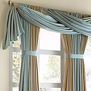 Drapery idea. Not really a valance but a nice swag topper to some drapery panels