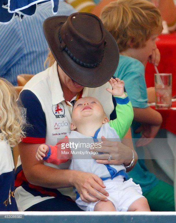 Autumn Phillips plays with Zara Phillips' daughter Mia Tindall as they attend day 2 of the Festival of British Eventing at Gatcombe Park on August 2, 2014 in Minchinhampton, England. (Photo by Max Mumby/Indigo/Getty Images)