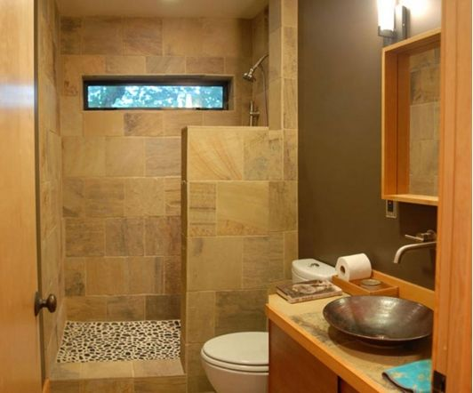 Open Concept Stone Shower With Small Dividing Wall