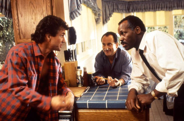 """Lethal Weapon 2"" movie still, 1989.  L to R: Mel Gibson, Joe Pesci, Danny Glover."