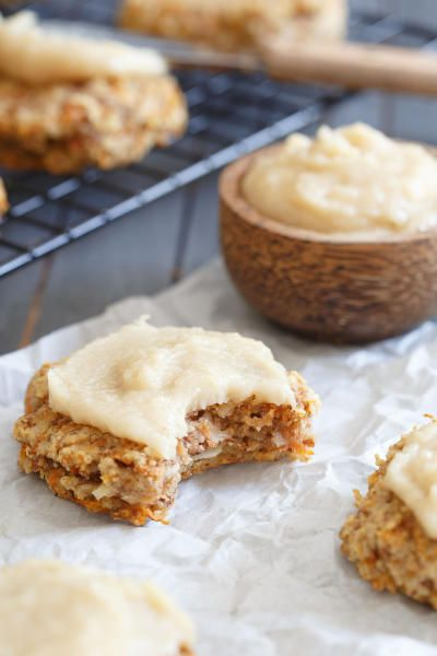 These paleo carrot cake cookies let you enjoy all the classic flavors of the cake minus the grains, dairy and sugar in one healthy bite! You even get that cream cheese frosting flavor too. Click through for recipe!
