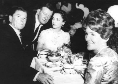 Wayne with wife, Pilar Pallete, and Ronald and Nancy Reagan.