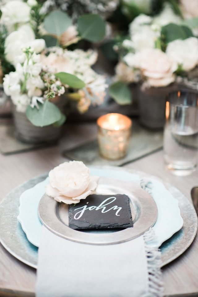 silver and light blue table setting with slate placecards