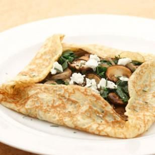 Try these crepes, filled with spinach and meaty mushrooms and topped with crumbled goat cheese, for a healthy dinner with a salad on the side. #bastilleday