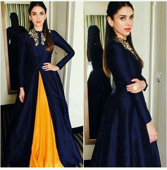 Aditi Rao Hydari looks elegantly gorgeous in a navy blue jacket and yellow lehenga. Love her hairstyle and coral lips. Indian Bollywood fashion.
