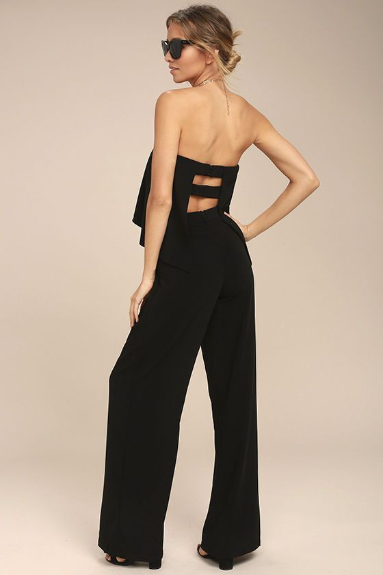 Being chic is easy with the Easy Living Black Strapless Jumpsuit! Sleek woven fabric falls from a strapless neckline (with no-slip strips), into a fluttering tier with a cutout back, and elasticized straps (with clasp closures). High-waisted bottoms finish with a dramatic flared hem. Hidden back zipper/clasp.