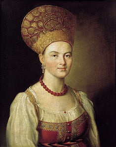 The portrait of an unknown girl in the Russian costume by Ivan Argunov, 1784, showcasing a large kokoshnik head dress.  ~ The kokoshnik (Russian: коко́шник; IPA: [kɐˈkoʂnʲɪk]) is commonly used name for a variety of a traditional Russian head-dresses worn by women and girls to accompany the sarafan, primarily worn in the northern regions of Russia in the 16th to 19th centuries.